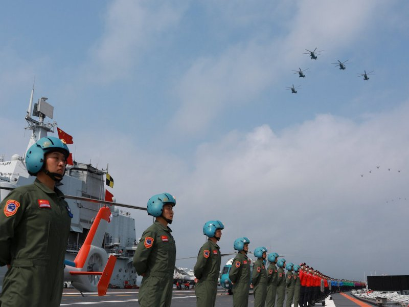 Navy personnel of Chinese People's Liberation Army (PLA) Navy take part in a military display in the South China Sea April 12, 2018. Picture taken April 12, 2018. Photo: Reuters/Stringer