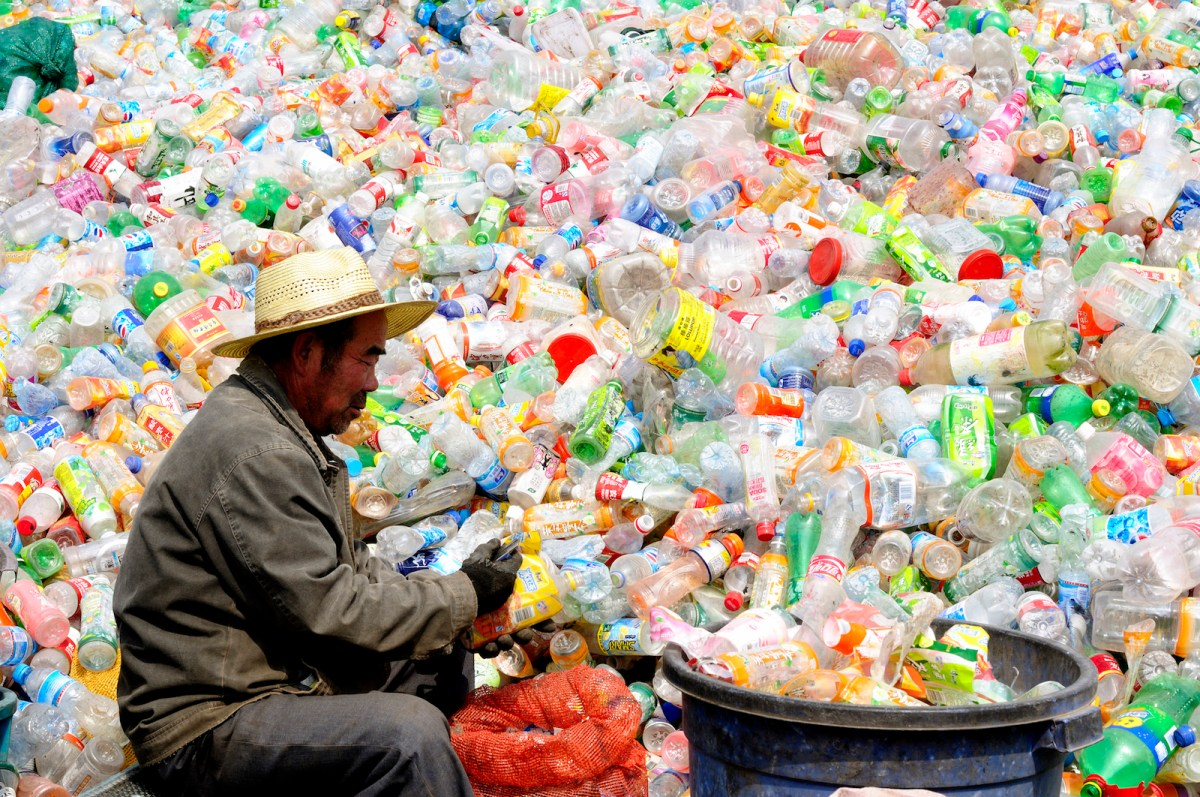 A Chinese worker sorts through plastic bottles for recycling. Photo: iStock