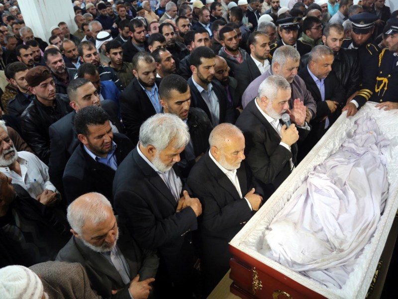 Hamas leader Ismail Haniyeh, center, says a prayer during the funeral ceremony of Fadi al-Batsh, the Palestinian Hamas engineer who was killed by unknown assailants in Kuala Lumpur, at Great Omari Mosque, at Jabalia Refugee Camp, before burying him at the Martyrs Cemetery in Gaza City on April 26. Al-Batsh was gunned down near his home in the Malaysian capital by two gunmen who fled the scene. Photo: Ismail Haniyeh's press office/ handout/ Anadolu Agency via AFP