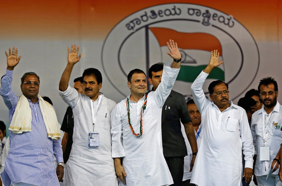 Rahul Gandhi, center, president of India's main opposition Congress party, waves to the crowd before addressing a campaign rally ahead of the Karnataka state election in Bangalore on April 8. Photo: Reuters/Abhishek Chinnappa