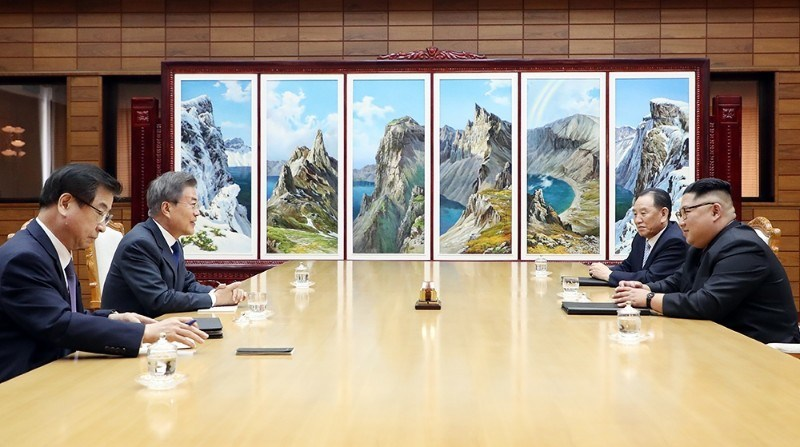 The leaders of the two Koreas, and related officials, at the conference table in Panmunjom, during their surprise summit on Saturday. Photo: The Blue House