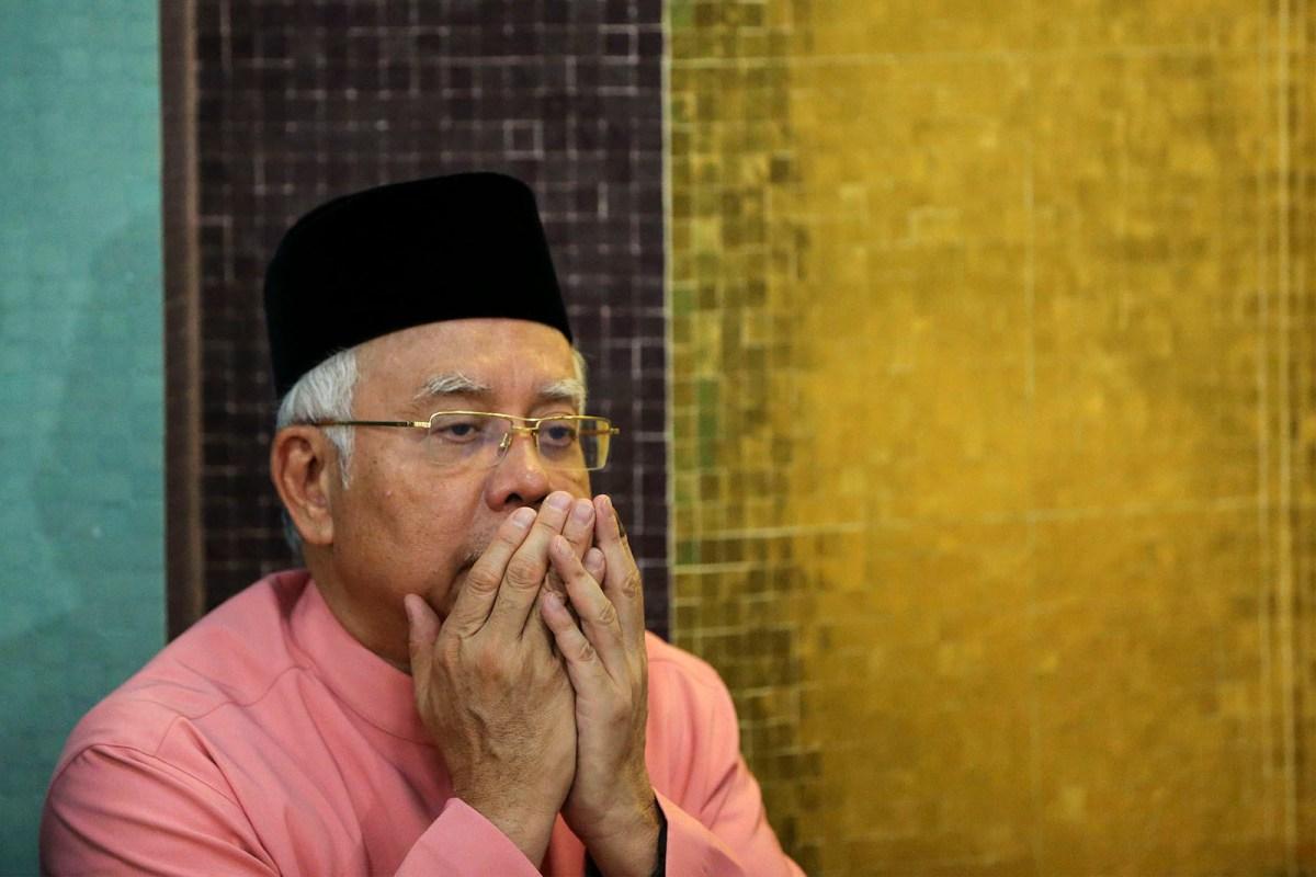 Malaysia's former Prime Minister Najib Razak prays at the United Malays National Organisation in Kuala Lumpur. Photo: AFP