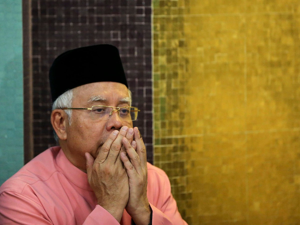 Malaysia's former Prime Minister Najib Razak prays at the United Malays National Organisation in Kuala Lumpur. Photo: AFP