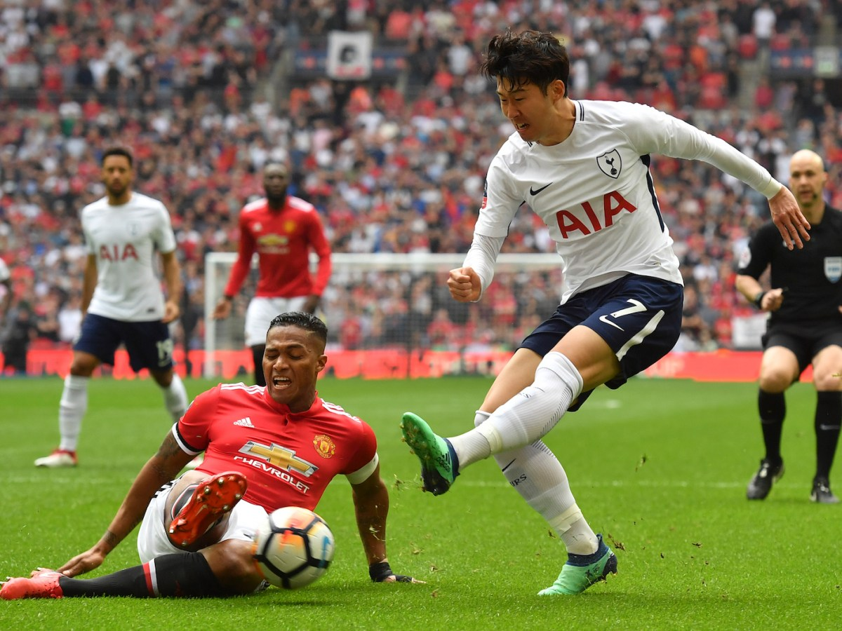 Tottenham and Japanese international Son Heung-Min sees his cross blocked by Manchester United's Antonio Valencia during the FA Cup semi-final at Wembley. Photo: AFP