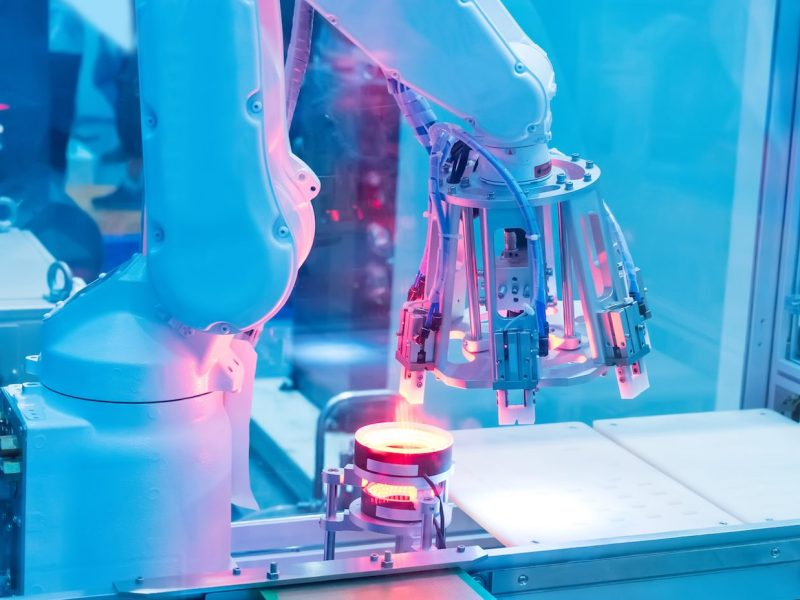 An automatic robot arm with optical sensors working in factory. Photo: iStock