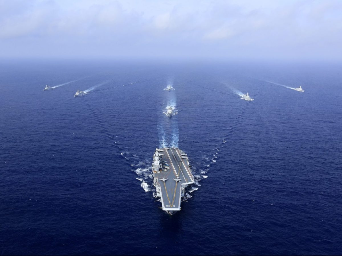 China's aircraft carrier, The Liaoning, followed by destroyers and frigates during a naval exercise on April 18, 2018. Photo: AFP