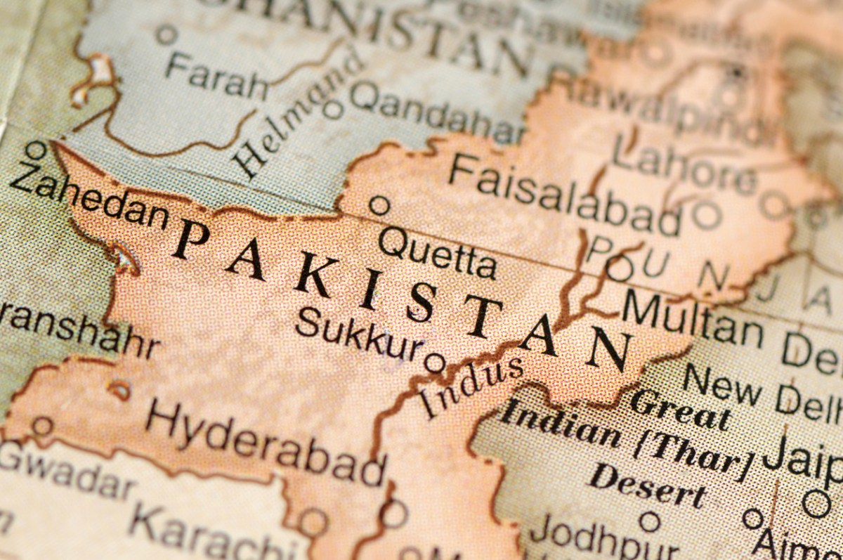 A close-up/macro photograph of Pakistan from a desktop globe. Adobe RGB color profile.