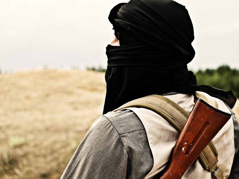 Muslim rebel with automatic rifle and machine-gun belt.  Photo: iStock