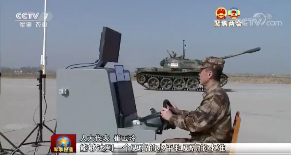 A video grab of a Chinese soldier manning a remote-control console during a field test of an unmanned T-59 tank. Image: CCTV