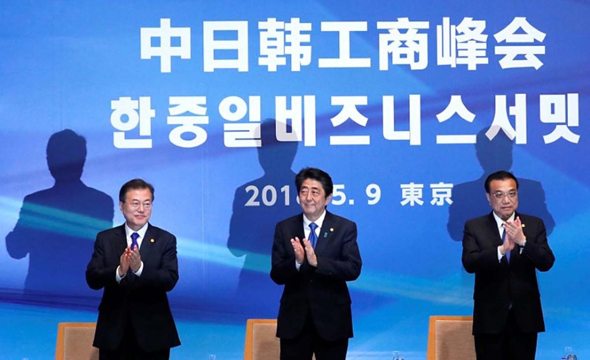 Japan's Prime Minister Shinzo Abe, South Korea's President Moon Jae-in and China's Premier Li Keqiang attend the 6th Japan-China-Korea Business Summit in Tokyo on Japan May 9, 2018. Photo: Reuters/Toru Hanai