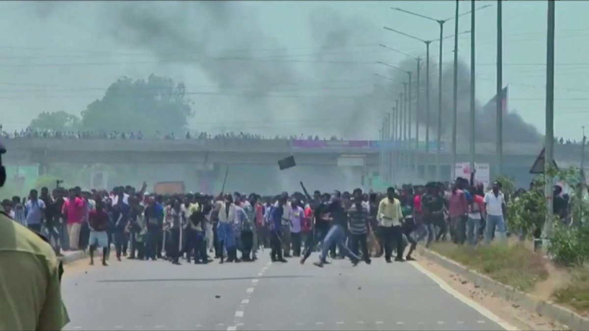 People throw stones during the rally against plans to expand a controversial copper smelter run by Vedanta Resources in Tamil Nadu, southern India. This is an image from video footage shot on May 22. Photo: ANI via Reuters TV.