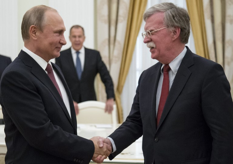 Russian President Vladimir Putin shakes hands with US National Security Adviser John Bolton during a meeting in Moscow on Wednesday. Photo: AFP / Alexander Zemlianichenko