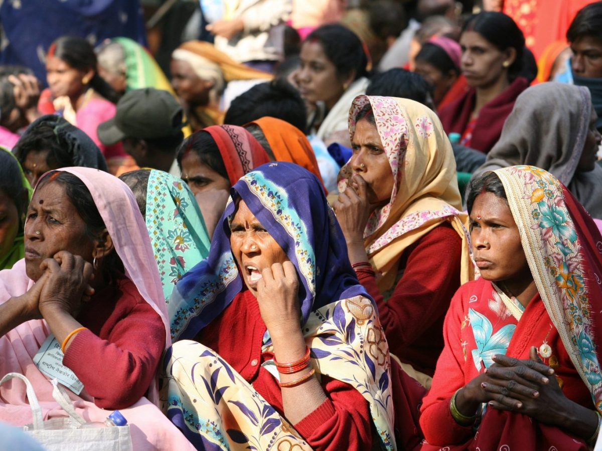 Indian women from the 'Dalit' or 'Untouchable' caste listen to a speaker during a Dalit Dignity Rally against the Congress-led UPA government near Parliament House in New Delhi on December 5, 2007. Photo: AFP/Raveendran