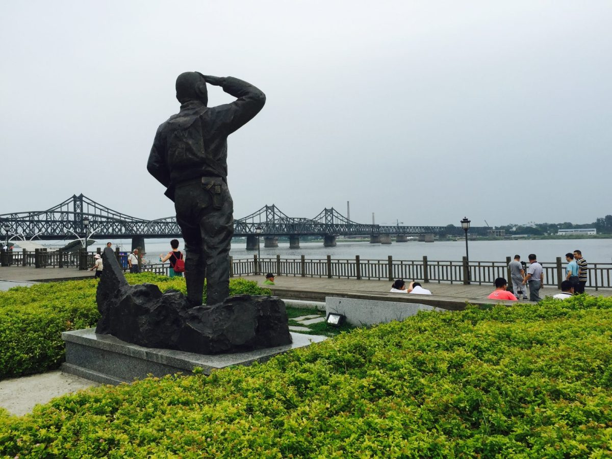 The state of a CPVA soldier salutes toward North Korea in a poignant memorial on the banks of the Yalu River, the border between China and North Korea. Photo: Andrew Salmon/Asia Times