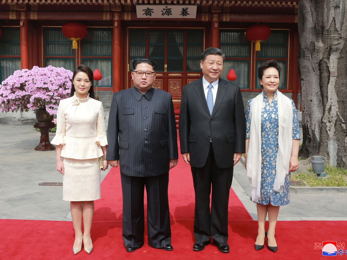 China's President Xi Jinping, second right, and his wife Peng Liyuan, right, pose with North Korean leader Kim Jong-un, second left, and his wife Ri Sol Ju, left, for a picture in Beijing in March. Photo: AFP/ KCNA via KNS