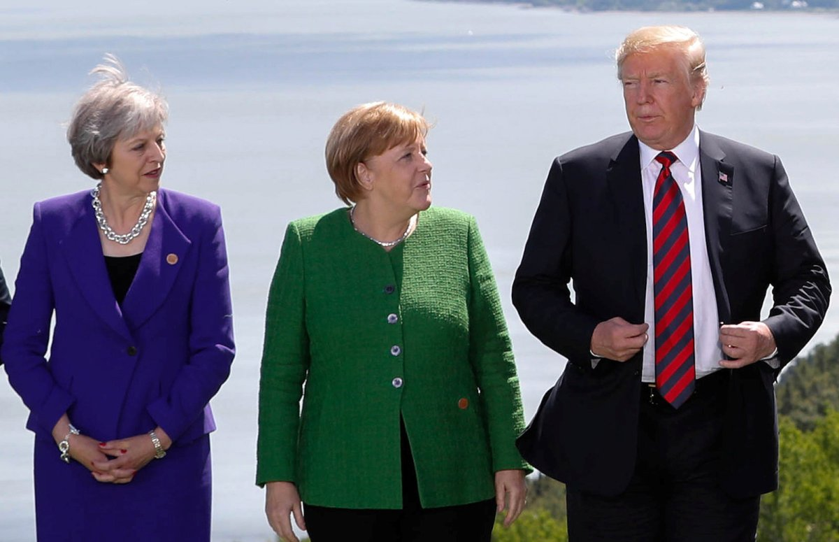 UK Prime Minister Theresa May, Germany's Chancellor Angela Merkel and US President Donald Trump at the G7 Summit. Photo: Reuters / Yves Herman.