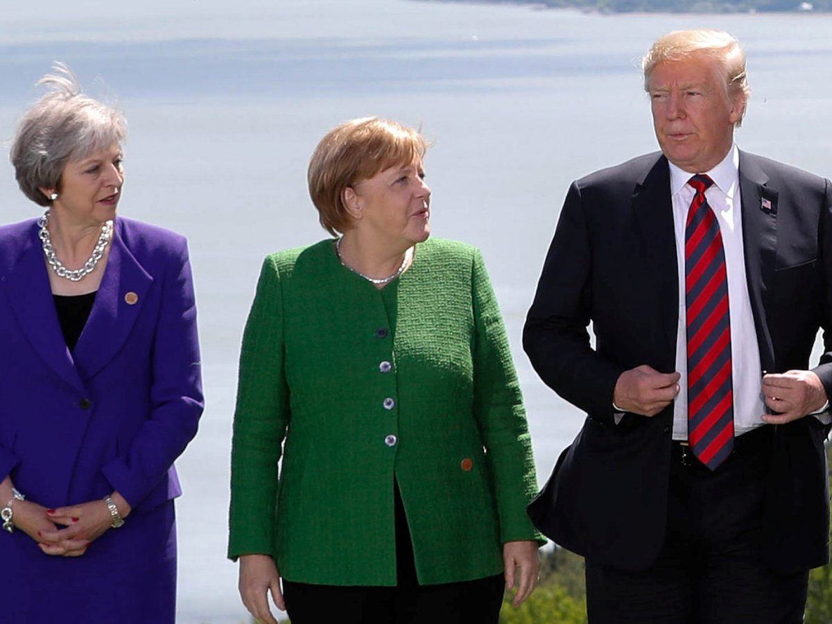 UK Prime Minister Theresa May, Germany's Chancellor Angela Merkel and US President Donald Trump at the G7 Summit. Photo: Reuters / Yves Herman.