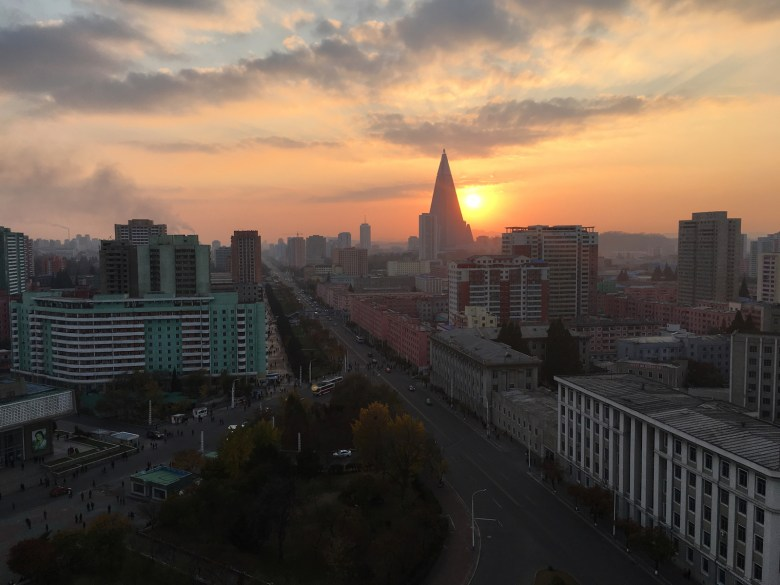 The unfinished 105-story Ryugyong Hotel looms large over a Pyongyang cityscape. Photo: Choson Exchange