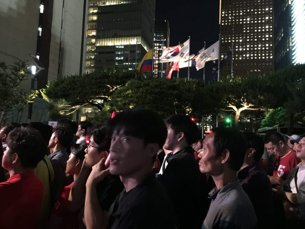Koreans watch their opening World Cup match in Seoul, Monday evening. Photo: Andrew Salmon/Asia Times