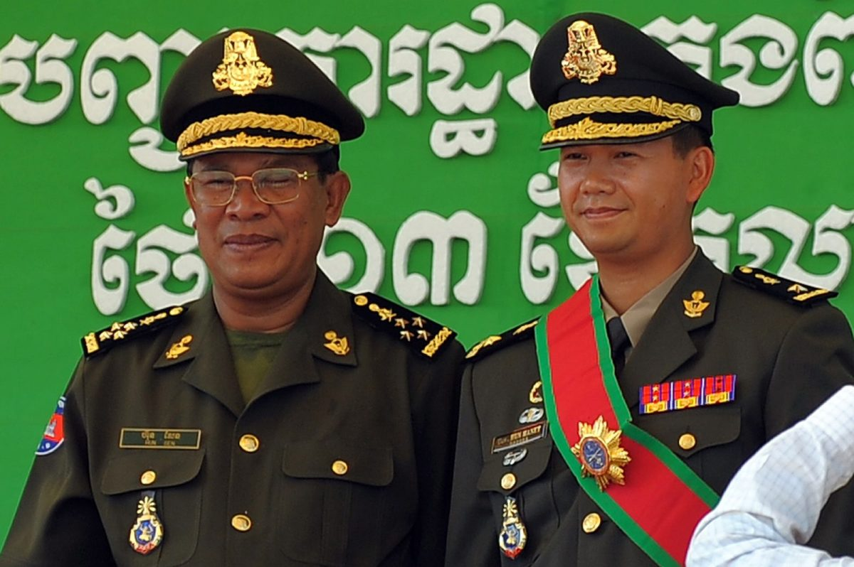Cambodian Prime Minister Hun Sen (L) with his West Point-trained son Hun Manet, who many think is being groomed to take over from his father some time after the July 29 elections. Photo: AFP/Tang Chhin Sothy