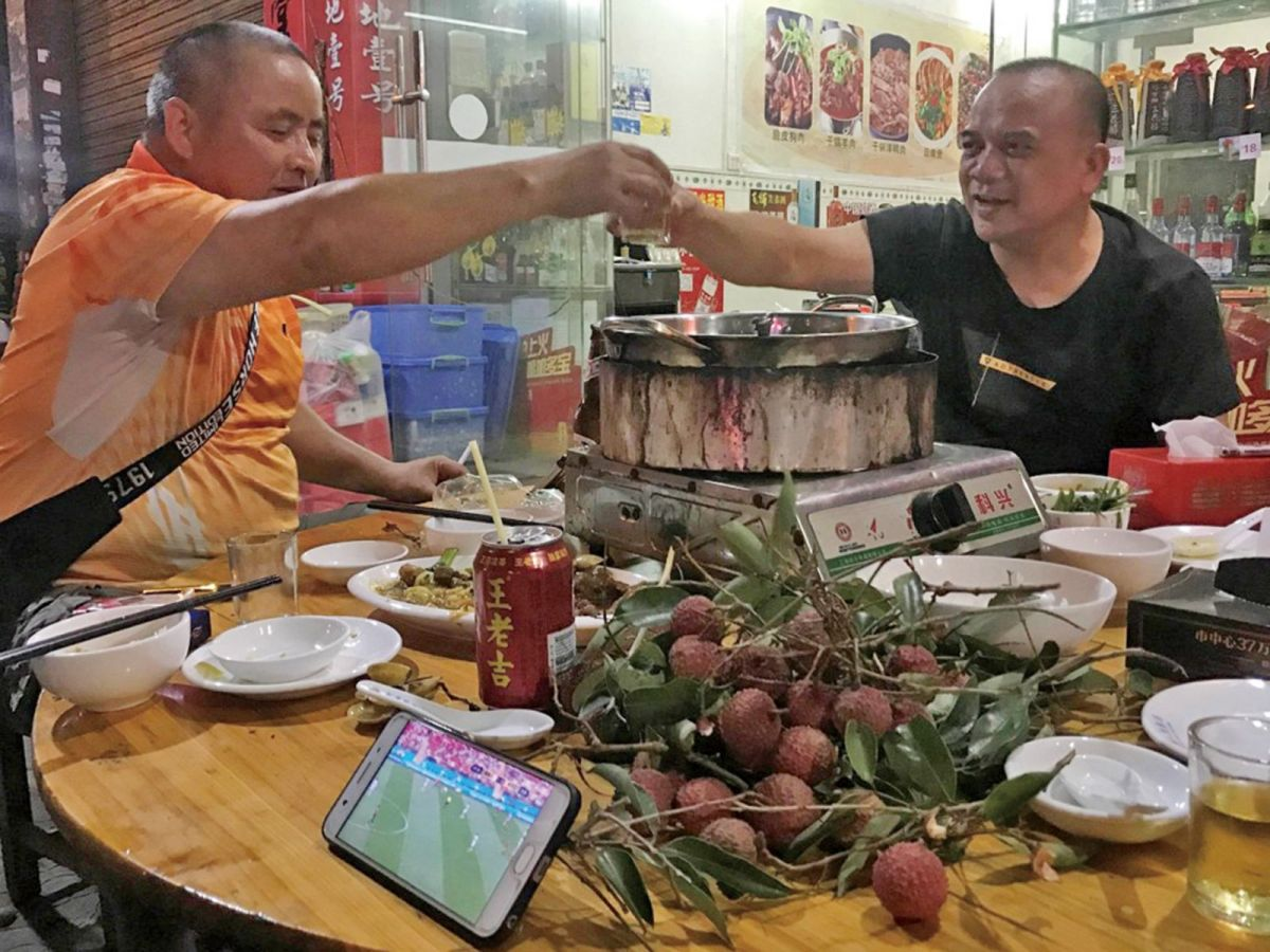 Two diners drink over a hot pot of dog meat in Yulin in southwestern China. Photo: Weibo