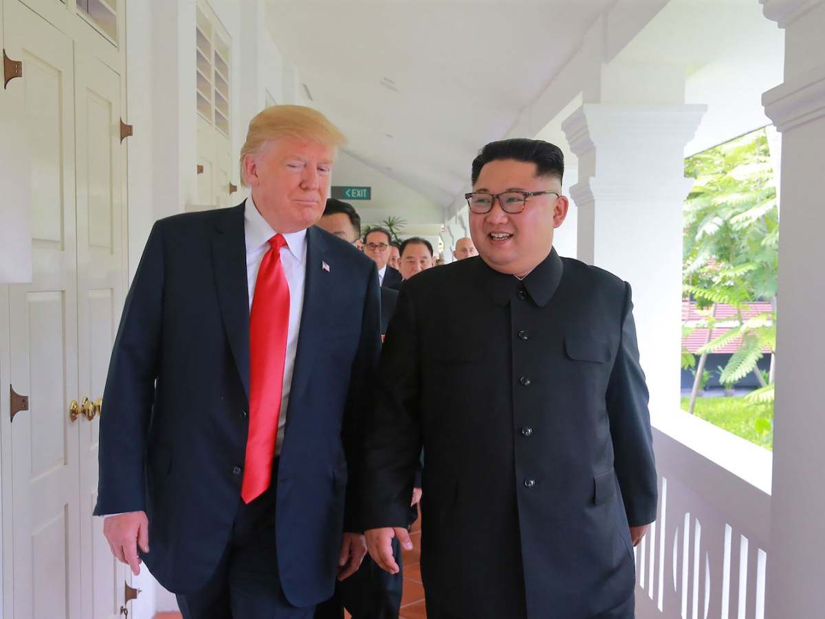 "In this picture taken on June 12, 2018 and released from North Korea's official Korean Central News Agency (KCNA) on June 13, 2018, US President Donald Trump (L) and North Korea's leader Kim Jong Un (R) walk after a meeting during their historic US-North Korea summit, at the Capella Hotel on Sentosa island in Singapore.  / AFP PHOTO / KCNA VIA KNS / - / South Korea OUT / REPUBLIC OF KOREA OUT ---EDITORS NOTE--- RESTRICTED TO EDITORIAL USE - MANDATORY CREDIT ""AFP PHOTO/KCNA VIA KNS"" - NO MARKETING NO ADVERTISING CAMPAIGNS - DISTRIBUTED AS A SERVICE TO CLIENTS / THIS PICTURE WAS MADE AVAILABLE BY A THIRD PARTY. AFP CAN NOT INDEPENDENTLY VERIFY THE AUTHENTICITY, LOCATION, DATE AND CONTENT OF THIS IMAGE. /"