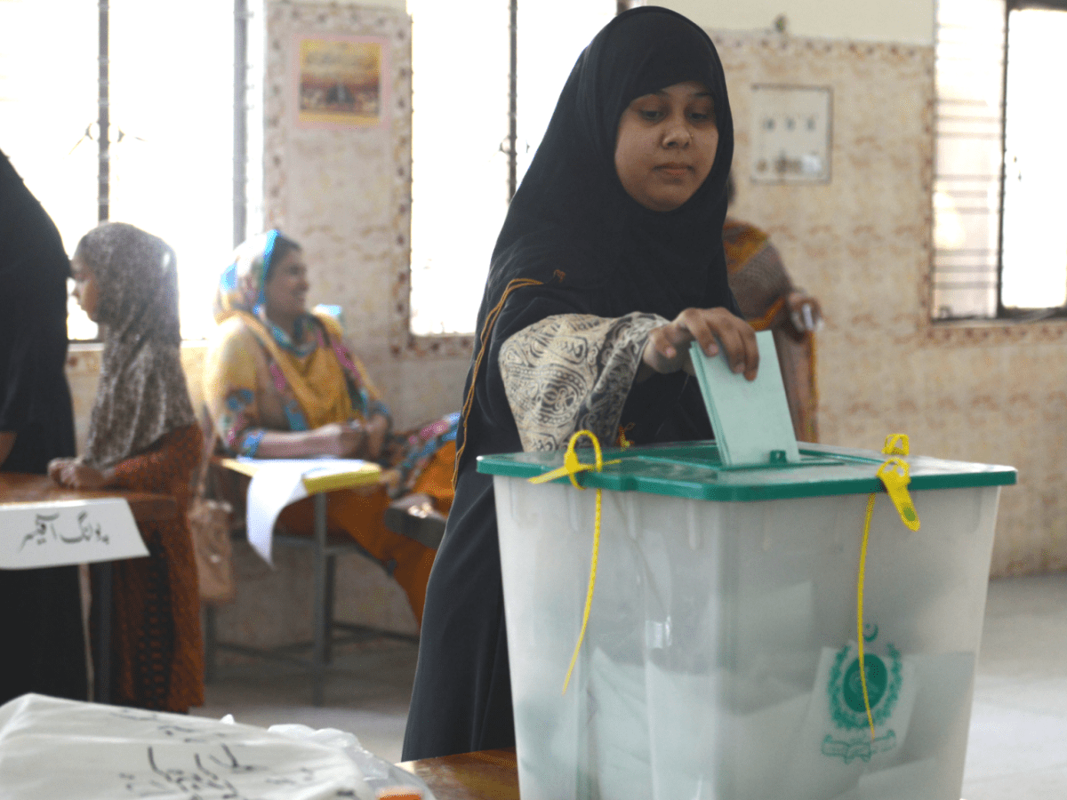 A Pakistani voter casts her ballot in a by-election in Lahore. File photo: AFP/Arif Ali