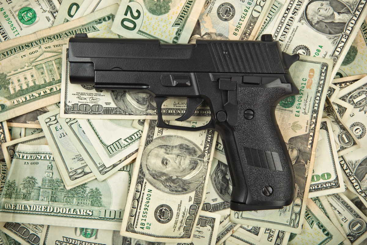 cash and gun. Photo: iStock