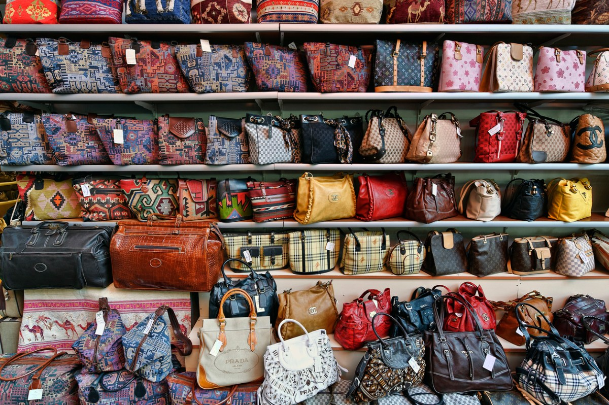 """Kusadasi, Turkey - October 23, 2008: An outdoor market in Kusadasi features counterfeit designer hand bags with the original designer logos at cheap prices."" Photo: iStock"