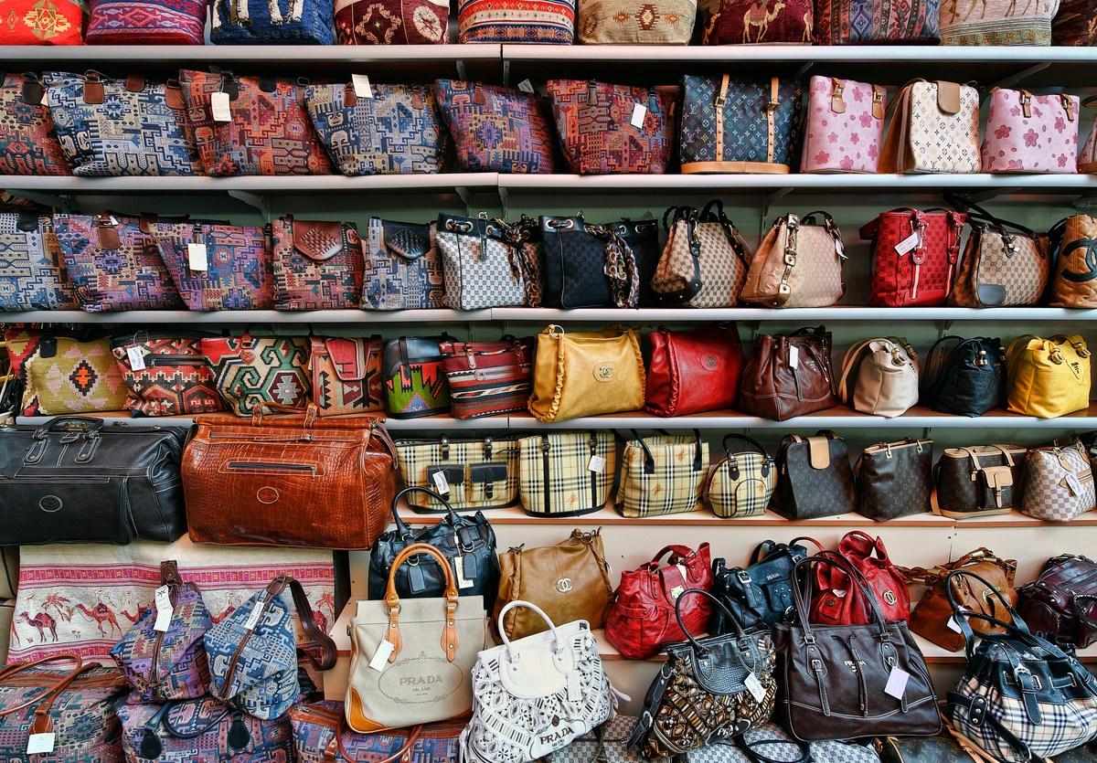 """Kusadasi, Turkey - October 23, 2008: An outdoor market in Kusadasi features counterfeit designer hand bags with the original designer logos at cheap prices."" Photo: iStock"