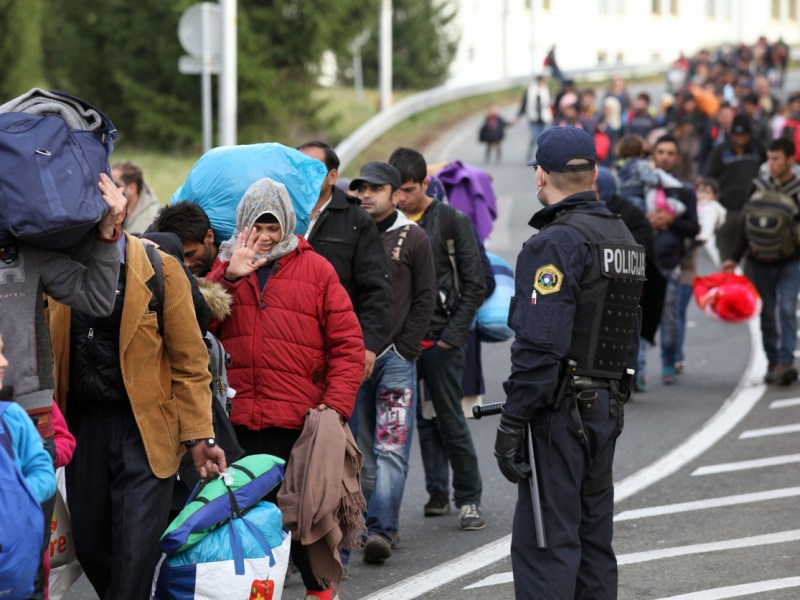 Migrants are escorted by Slovenian police to the Austrian border. Photo: iStock