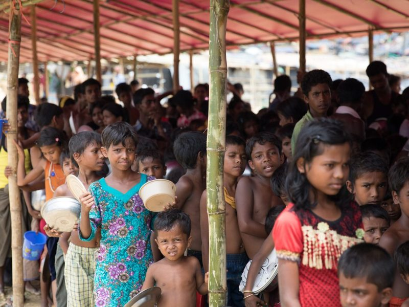 Rohingya children waiting for food in refugee camp in Bangladesh. Food is distributed by Turkish NGO. Photo: iStock