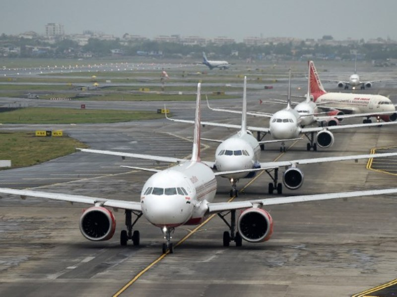 Aircraft queue up on the tarmac before taking off at Mumbai airport: AFP