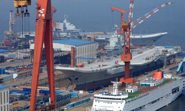 One port, two carriers: Liaoning and her sister carrier, Type 001A, are seen at the Dalian Shipyard in May 2018. Photo: Weibo