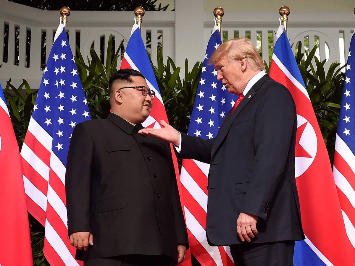 US President Donald Trump meets with North Korean leader Kim Jong Un in Singapore on June 12, 2018. Photo: AFP/Saul Loeb