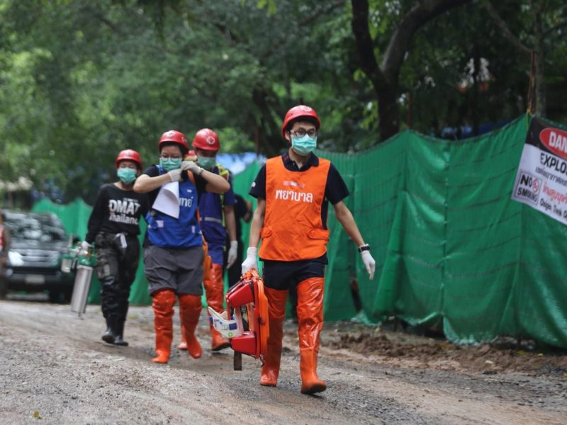 Thai rescue personnel carrying a stretcher in Tham Luang cave area after divers evacuated some of the 12 boys and their coach trapped in the cave in Khun Nam Nang Non Forest Park in the Mae Sai district on July 8, 2018. Photo: AFP / CHIANG RAI PUBLIC RELATIONS OFFICE