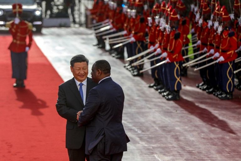 Senegal's President Macky Sall greets China's President Xi Jinping as he arrives at the Palace of the Republic in Dakar. Photo: AFP