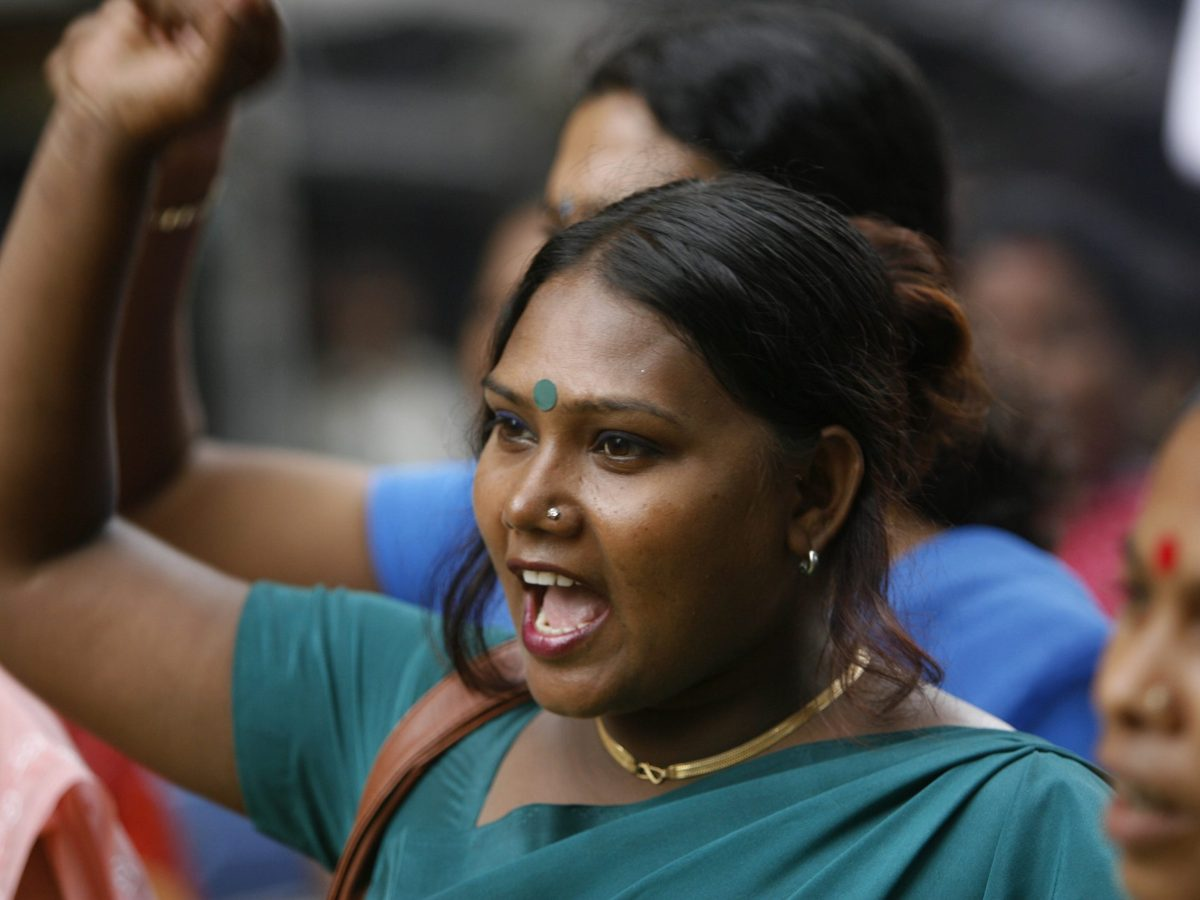 An Indian sex worker shouts slogans during a protest march in Kolkata on July 01, 2008, against the proposed amendments to the Immoral Trafficking (Prevention) Act in Parliament. Photo: AFP /  Deshakalyan Chowdhury