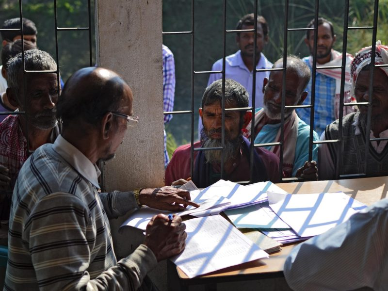 "People wait to check their names on the first draft of the National Register of Citizens (NRC) at Goroimari of Kamrup district in the Indian state of Assam on January 1, 2018. Around 13 million people in northeastern India's Assam woke up to uncertainty on January 1 after the release of an official citizenship registry with names of only 19 million of the state's over 32 million residents. The national registry of citizens (NRC) has been in works for years, after strident, decades long demands by many local groups to identify and evict ""illegal foreigners"" settling in the state. / AFP PHOTO / Kulendu Kalita"