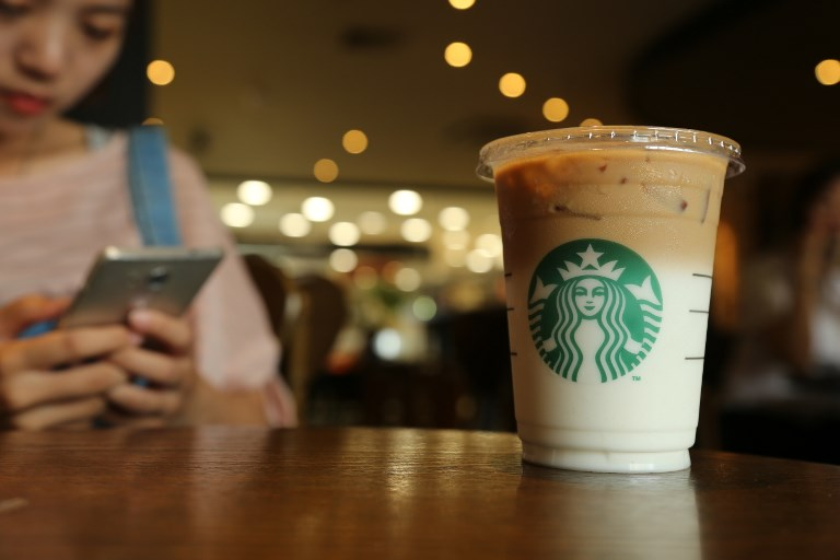 Starbucks has launched the Bakkt platform, a joint venture with the Intercontinental Stock Exchange (parent of the NYSE), Microsoft and others, that will enable 'consumers and institutions to buy, sell, store and spend digital assets on a seamless global network.' Photo: AFP
