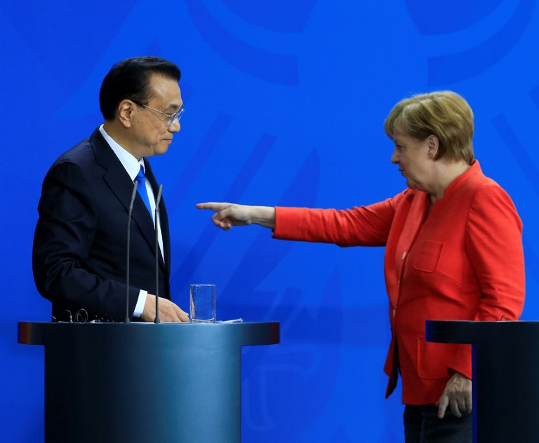German Chancellor Angela Merkel and Chinese Prime Minister Li Keqiang at a press conference in Berlin on Monday. Photo: AFP