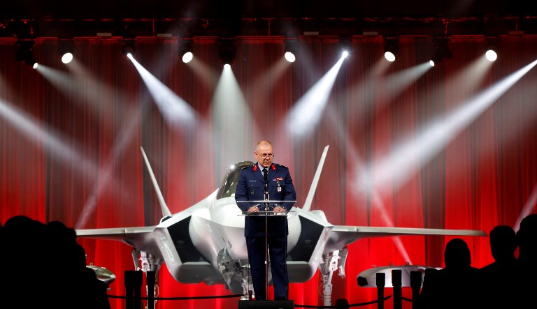 Major General Reha Ufuk Er makes a speech as Turkey takes delivery of its first F-35 fighter jet with a ceremony in Texas. Photo: Anadolu Agency via AFP