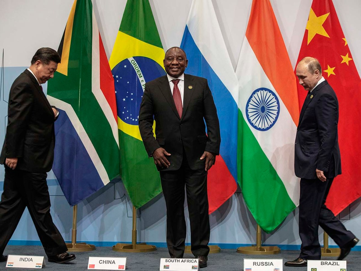 China's President Xi Jinping, South Africa's President Cyril Ramaphosa and Russia's President Vladimir Putin arrive for a group picture during the 10th BRICS summit on July 26, 2018 in Johannesburg. Photo: AFP/Gianluigi Guercia