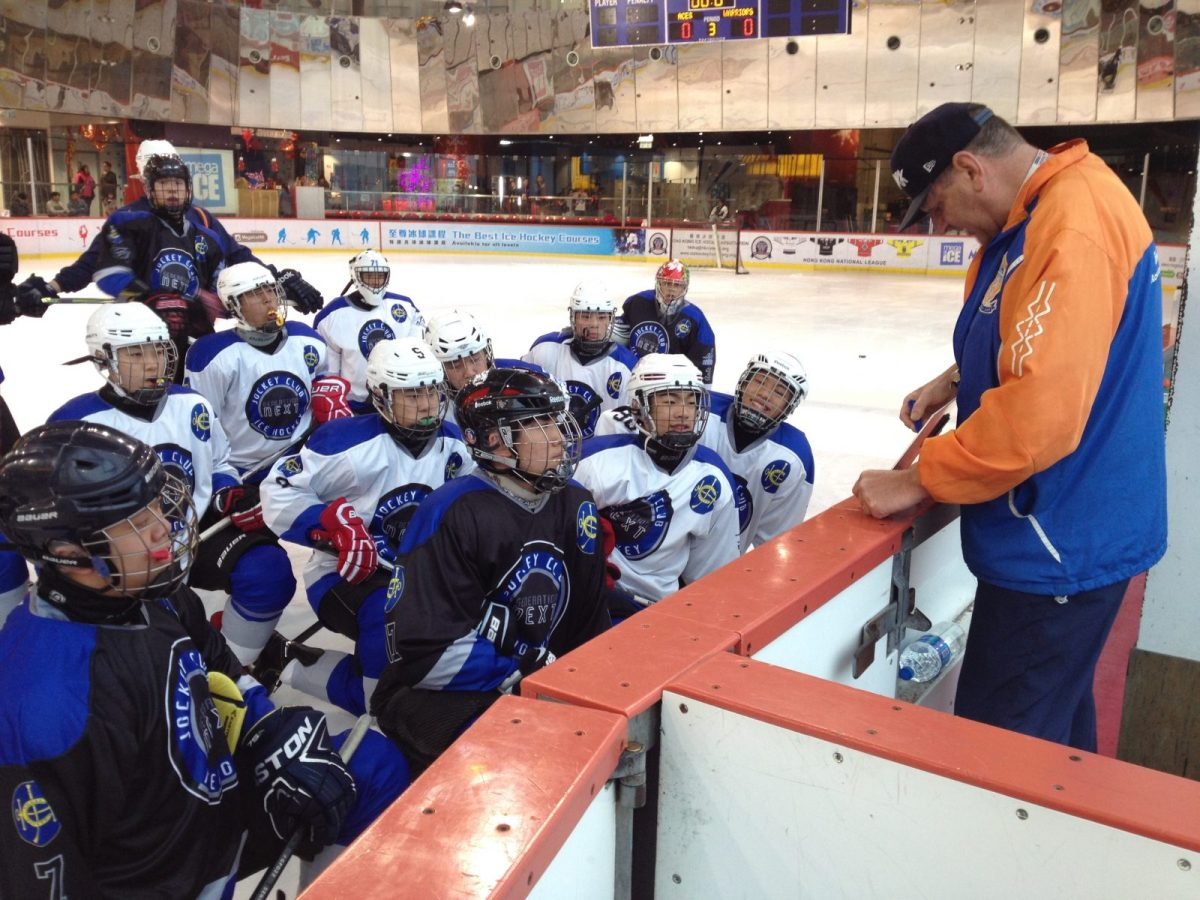 Barry Beck teaches a hockey class of youngsters at the Hong Kong Academy of Ice  Hockey in Kowloon. Photo courtesy Barry Beck