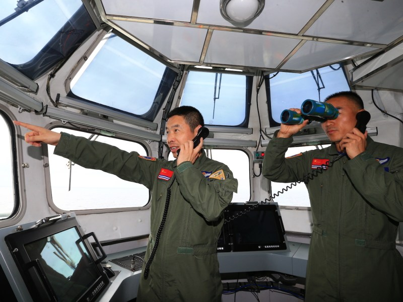 Chinese commanders of the People's Liberation Army Navy direct J-15 fighter jets to take off from China's aircraft carrier, The Liaoning, during a naval exercise in the South China Sea, April 20, 2018. Photo: AFP Forum