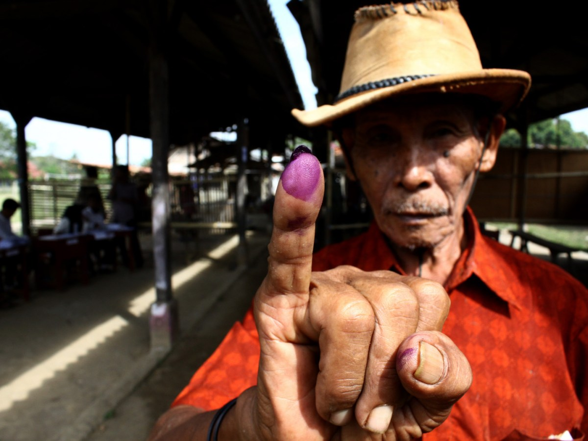 An Indonesian voter at a pooling station during local elections held in June, 2018 Photo: AFP Forum/ Aditya Irawan