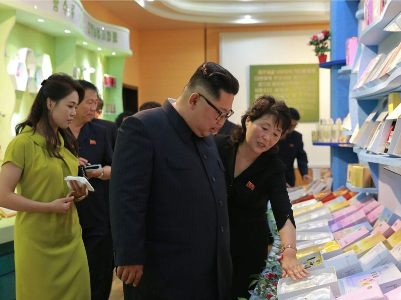 An undated photo of North Korean leader Kim Jong-un and his wife Ri Sol-ju visiting a cosmetics factory in Sinuiju. There are no figures available on North Korea's industrial output. Photo: AFP/KCNA via KNS