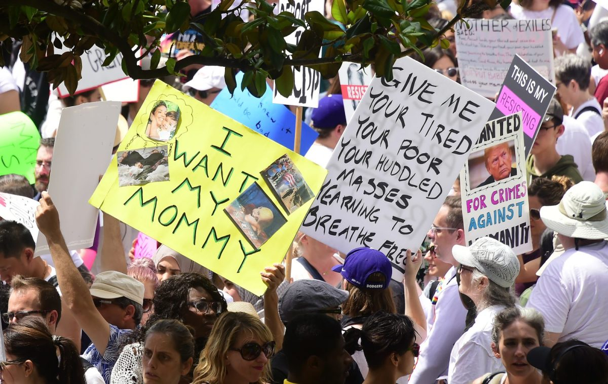 People hold placards during a 'Familes Belong Together' march and rally in Los Angeles, California, on June 30, 2018. Thousands of demonstrators marched across the US on Saturday to protest against the separation of families under President Donald Trump's hardline agenda. Photo: AFP/Frederic J. Brown