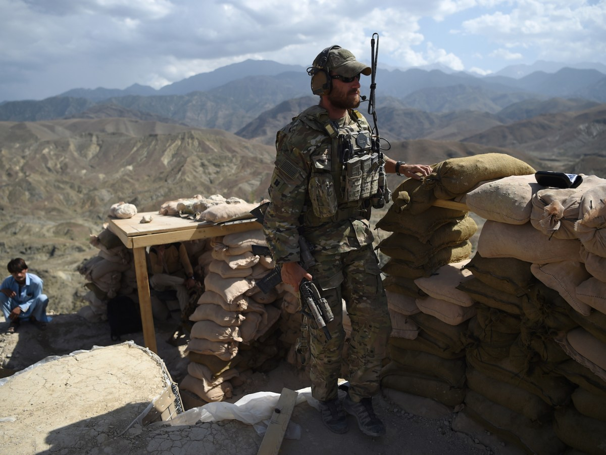 A US Army soldier from NATO and an Afghan policeman are seen at a checkpoint during a patrol against Islamic State militants at the Deh Bala district in eastern Nangarhar province in Afghanistan. Photo: AFP/ Wakil Kohsar