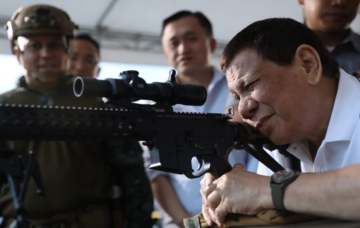 President Rodrigo Duterte fires a few rounds with a sniper rifle during the opening ceremony of the National Special Weapons and Tactics (SWAT) Challenge in Davao City, southern Philippine island of Mindanao. Photo: AFP/Presidential Photo Division/Joey Dalumpines